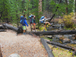 The middle school mountaineers hike to their campsite at the Cottonwood Lakes.
